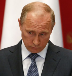 Russian President Vladimir Putin takes part in a news conference after meeting with Swiss Federal President Didier Burkhalter in the Kremlin in Moscow, Wednesday, May 7, 2014. (AP Photo/Sergei Karpukhin, Pool)