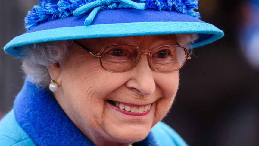 Britain's Queen Elizabeth II attends a ceremony at Tweedbank Station in Tweedbank on the Scottish Borders on September 9, 2015 to officially open the Borders Railway on the day that The Queen becomes Britain's longest-serving monarch. Britain celebrated Queen Elizabeth II becoming the country's longest-serving monarch with a flotilla down the River Thames, a gun salute and the peal of Westminster Abbey's bells.   AFP PHOTO / LEON NEAL        (Photo credit should read LEON NEAL/AFP/Getty Images)