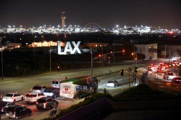 Traffic congestion is seen near the LAX sign, as terminals at Los Angeles International Airport were evacuated briefly late on Sunday following a false alarm, in Los Angeles, California, U.S., June 28, 2016.  REUTERS/Bob Riha Jr