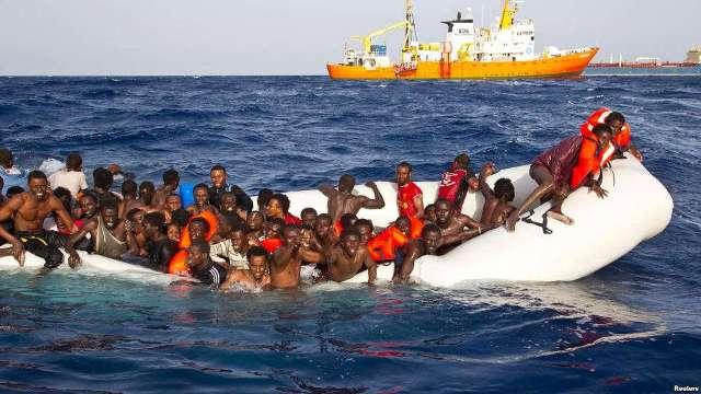 мігранти