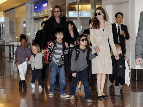 Brangelina and the kids, Maddox, Pax, Zahara, Shiloh, Vivienne and Knox, landed in Japan at Tokyo's Haneda International Airport. Hundreds of screaming fans waited for hours to catch a glimpse of the Hollywood stars and were delighted to see the whole family arrive. Brad is in Japan to promote his new film, 'Moneyball.'  Pictured: Brad Pitt, Angelina Jolie, Maddox Jolie-Pitt, Pax Jolie-Pitt, Zahara Jolie-Pitt, Shiloh Jolie-Pitt and Vivienne Jolie-Pitt  Ref: SPL320826  071111   Picture by: Scott Larson /  / Splash News  Splash News and Pictures Los Angeles:	310-821-2666 New York:	212-619-2666 London:	870-934-2666 photodesk@splashnews.com  All Over Press